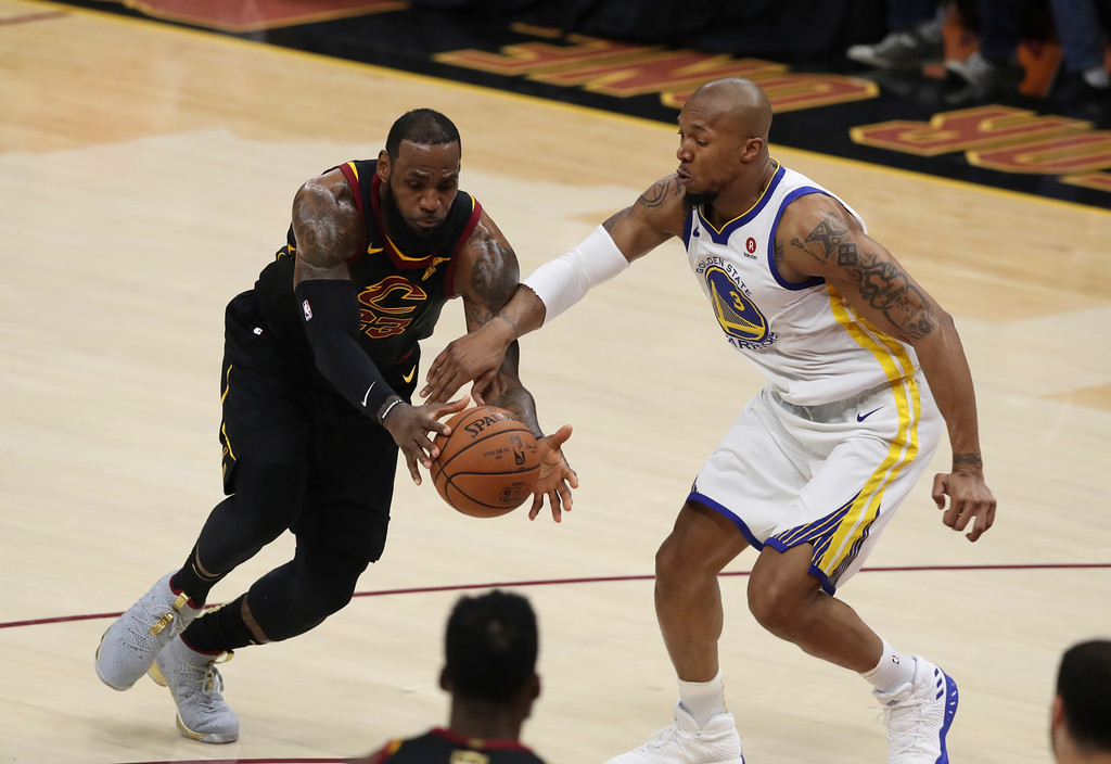 . Cleveland Cavaliers\' LeBron James and Golden State Warriors\' David West battle for loose ball in the first half of Game 3 of basketball\'s NBA Finals, Wednesday, June 6, 2018, in Cleveland. (AP Photo/Carlos Osorio)