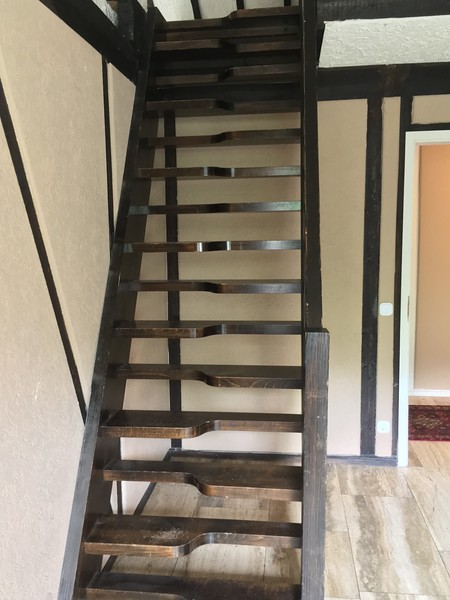 Stairs leading upstairs to loft/bedroom.