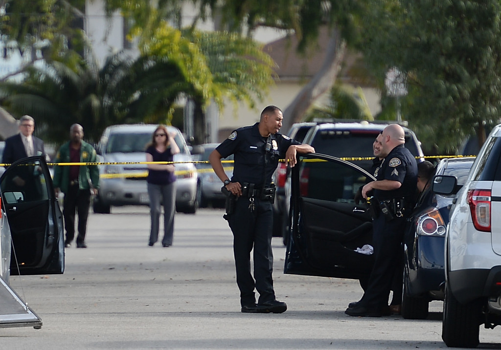 . Police investigate the scene of an officer involved shooting on Ruthelen Avenue Monday, March 03, 2014, Gardena, CA.   Gardena police responded to a call of a residential burglary and shot one of the suspects. Photo by Steve McCrank/Daily Breeze