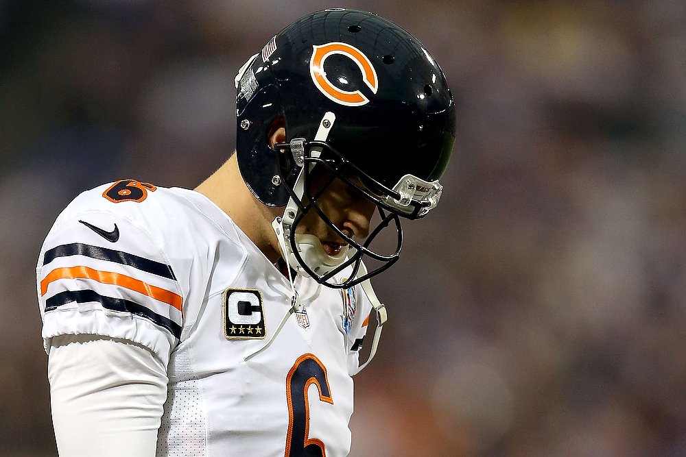 . Quarterback Jay Cutler#6 of the Chicago Bears walks back to the huddle after throwing a incomplete pass against the Minnesota Vikings at Mall of America Field on December 9, 2012 in Minneapolis, Minnesota.  (Photo by Matthew Stockman/Getty Images)