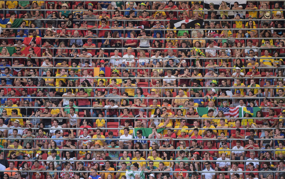 . Fans follows the action the Group G football match between Portugal and Ghana at the Mane Garrincha National Stadium in Brasilia during the 2014 FIFA World Cup on June 26, 2014.  (GABRIEL BOUYS/AFP/Getty Images)