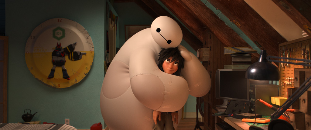""". This image released by Disney shows animated characters Hiro Hamada, voiced by Ryan Potter, right, and Baymax, voiced by Scott Adsit, in a scene from \""""Big Hero 6.\""""  The film was nominated for a Golden Globe for best animated feature on Thursday, Dec. 11, 2014. The 72nd annual Golden Globe awards will air on NBC on Sunday, Jan. 11. (AP Photo/Disney)"""
