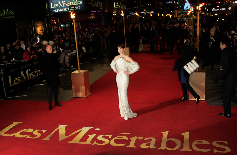 Description of . Anne Hathaway arrives on the red carpet for the World Premiere of 'Les Miserables' at a central London cinema in Leicester Square, Wednesday, Dec. 5, 2012. (Photo by Joel Ryan/Invision/AP)