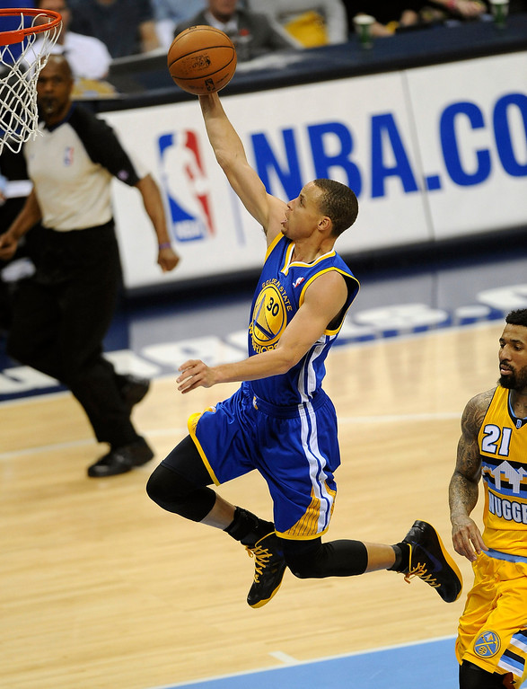 . DENVER, CO. - APRIL 20: Golden State point guard Stephen Curry scores on a breakaway in the fourth quarter against Denver. The Denver Nuggets defeated the Golden State Warriors 97-95 in Game 1 of the Western Conference First Round Series at the Pepsi Center in Denver, Colo. on April 20, 2013. (Photo by Steve Nehf/The Denver Post)