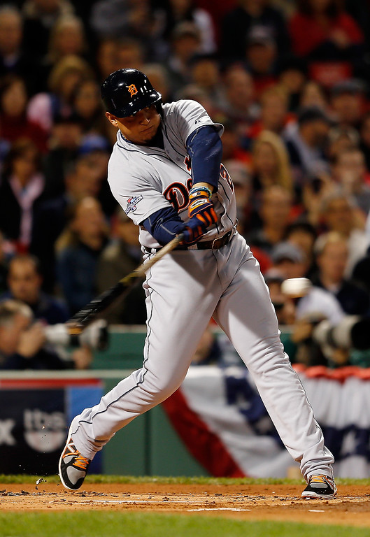 . Miguel Cabrera #24 of the Detroit Tigers bats against the Boston Red Sox in the first inning of Game Two of the American League Championship Series at Fenway Park on October 13, 2013 in Boston, Massachusetts.  (Photo by Jim Rogash/Getty Images)