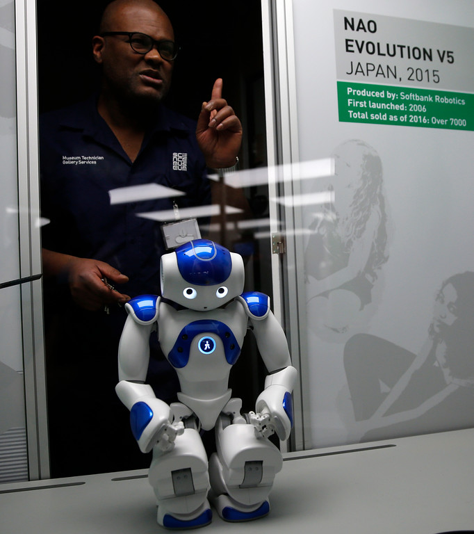 . A technician adjusts Nao Evolution robot from Japan, during a press preview for the Robots exhibition held at the Science Museum in London, Tuesday, Feb. 7, 2017. The exhibition which shows 500 years of mechanical and robotic advances is open to the public form Feb. 8 through to Sept. 3. (AP Photo/Alastair Grant)