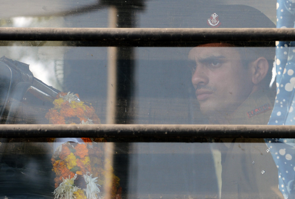 . An Indian soldier, holding a wreath, waits inside a military truck for the arrival of the bodies of two comrades, allegedly killed by Pakistani soldiers in a cross-border skirmish in the disputed Kashmir region, at the New Delhi Air Force Station on January 9, 2012. India delivered a dressing-down to Islamabad\'s envoy to Delhi as it accused Pakistan\'s army of beheading one of two soldiers killed in Kashmir, but both sides warned against inflaming tensions. RAVEEN DRAN/AFP/Getty Images
