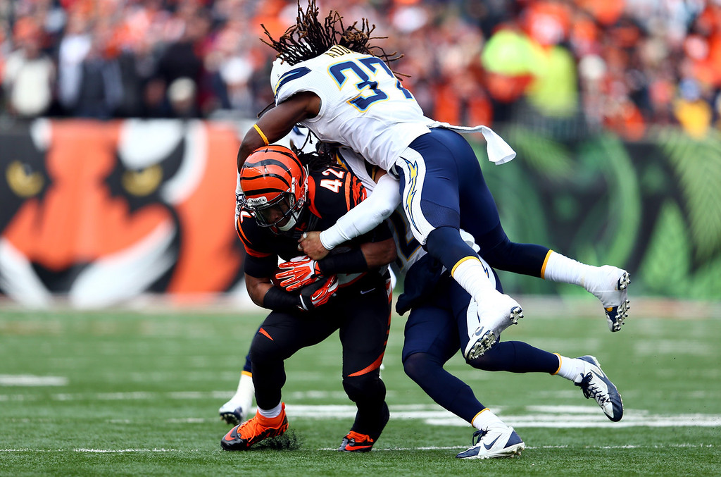 . Running back BenJarvus Green-Ellis #42 of the Cincinnati Bengals is tackled by defensive back Jahleel Addae #37 of the San Diego Chargers during a Wild Card Playoff game at Paul Brown Stadium on January 5, 2014 in Cincinnati, Ohio.  (Photo by Andy Lyons/Getty Images)