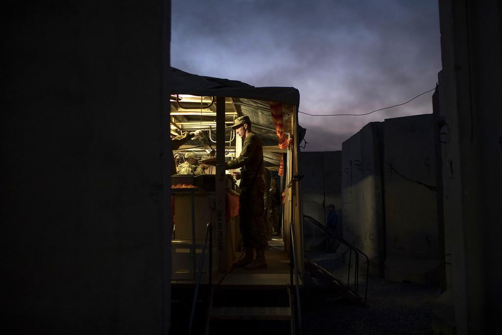 . An U.S. military member is served Thanksgiving dinner at a coalition air base in Qayara south of Mosul, Iraq, Thursday, Nov. 24, 2016. (AP Photo/Felipe Dana)