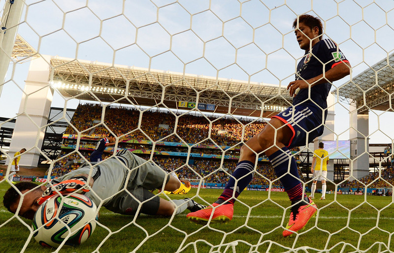 . Colombia\'s goalkeeper David Ospina (L) lies on the goal after Japan\'s forward Shinji Okazaki (not pictured) scored during a Group C football match between Japan and Colombia at the Pantanal Arena in Cuiaba during the 2014 FIFA World Cup on June 24, 2014. (TOSHIFUMI KITAMURA/AFP/Getty Images)