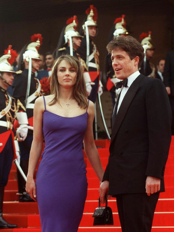 . British movie star Hugh Grant arrives with Liz Hurley at the Festival Palace in Cannes on Sunday May 11, 1997, to attend the 50th birthday celebration of the Cannes International Film Festival.(AP PHOTO/Laurent Rebours)