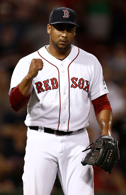 . Boston Red Sox relief pitcher Pedro Beato pumps his fist after recording the final out of Boston\'s 11-4 win over the Colorado Rockies in a baseball game at Fenway Park in Boston on Tuesday, June 25, 2013. (AP Photo/Winslow Townson)