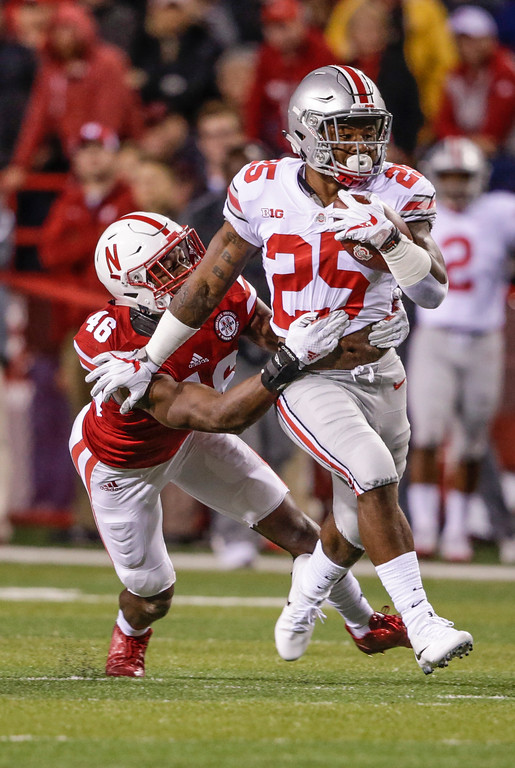 . Ohio State running back Mike Weber (25) is tackled by Nebraska defensive back Joshua Kalu (46) during the first half of an NCAA college football game in Lincoln, Neb., Saturday, Oct. 14, 2017. (AP Photo/Nati Harnik)