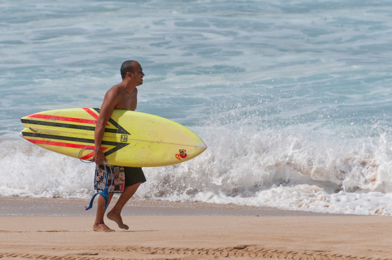 Surfer on the beach of Oahu, Hawaii
