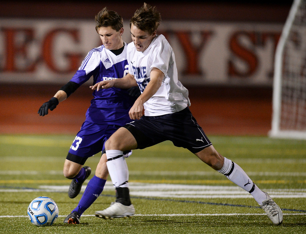 . Nick Bannister of Pine Creek High School (11) and Mitchell Davis of Boulder High School (23) fight for control of the ball in the first half of the game at Legacy Stadium in Aurora. (Photo by Hyoung Chang/The Denver Post)