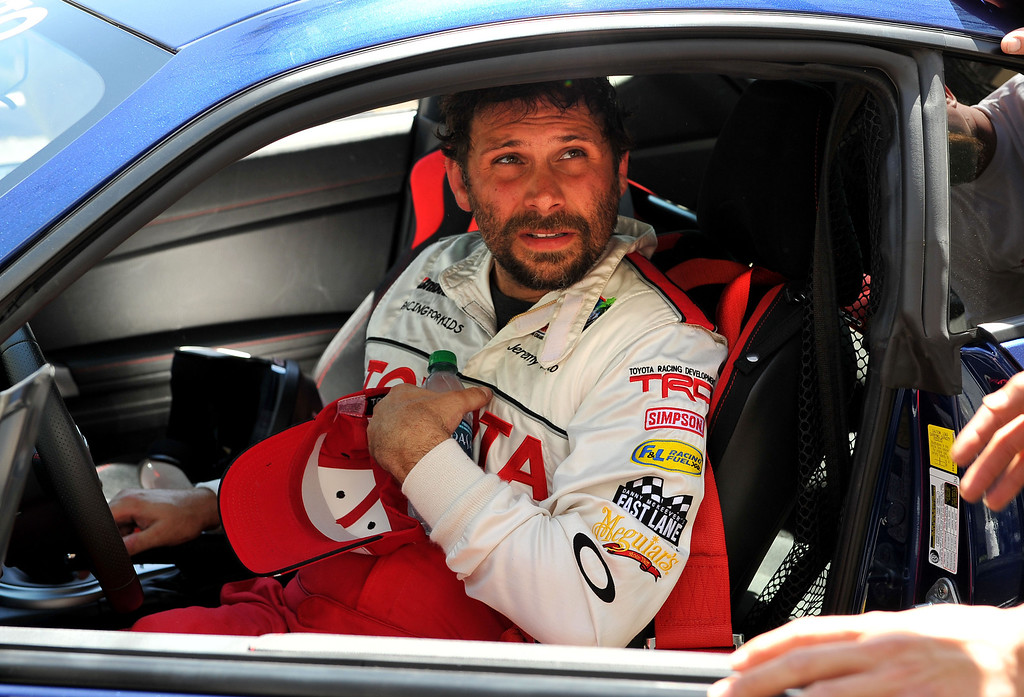 . 4/19/13 - Jeremy Sisto exits his car after the Friday morning practice of the Toyota Pro/Celebrity race at the 39th Annual Toyota Grand Prix of Long Beach. Photo by Brittany Murray / Staff Photographer