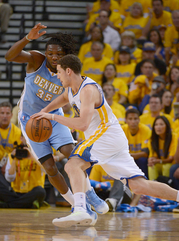 . OAKLAND, CA - APRIL 28:Klay Thompson (11) of the Golden State Warriors drives on Kenneth Faried (35) of the Denver Nuggets during the second quarter in Game 4 of the first round NBA Playoffs April 28, 2013 at Oracle Arena. (Photo By John Leyba/The Denver Post)