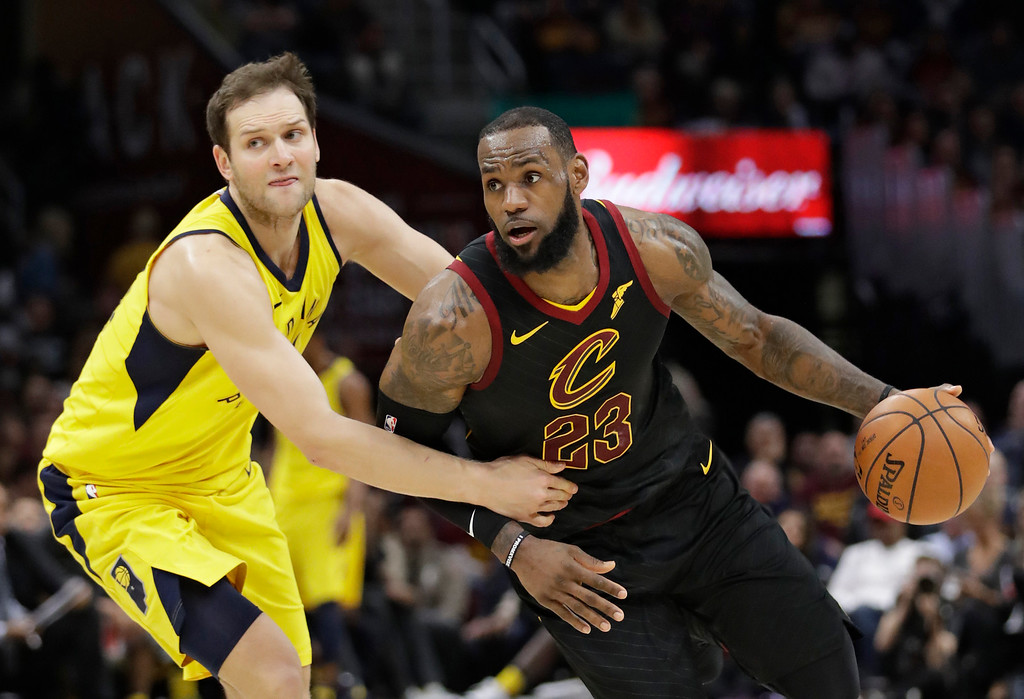 . Cleveland Cavaliers\' LeBron James (23) drives past Indiana Pacers\' Bojan Bogdanovic (44), from Croatia, in the first half of Game 5 of an NBA basketball first-round playoff series, Wednesday, April 25, 2018, in Cleveland. (AP Photo/Tony Dejak)