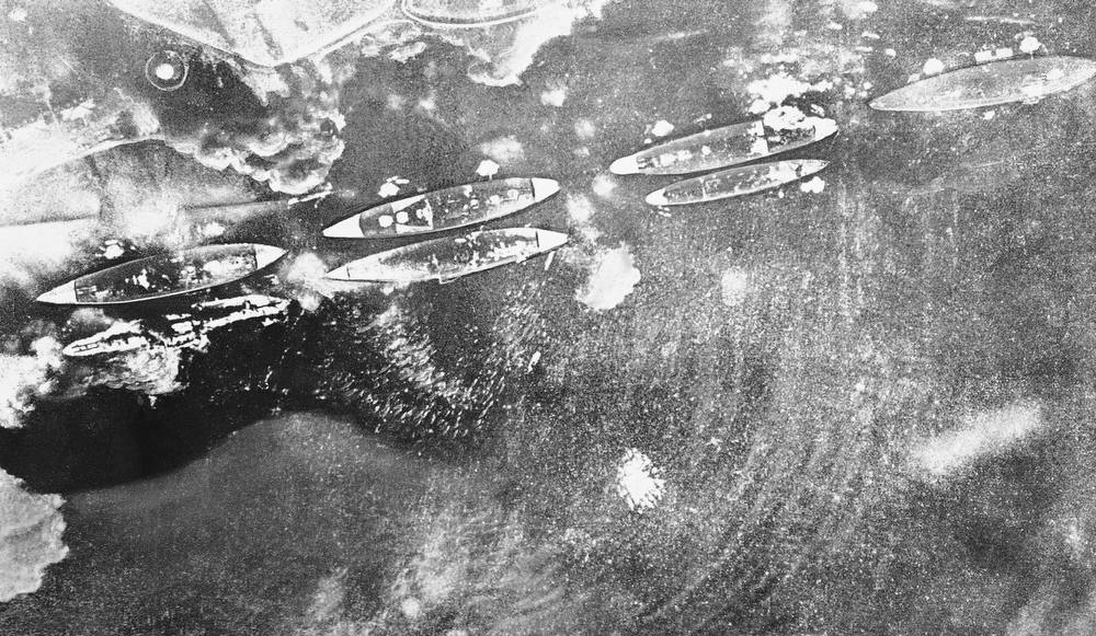 Description of . This Japanese navy air view of smoking U.S. ships during Pearl Harbor attack appeared in a 1942  publication called