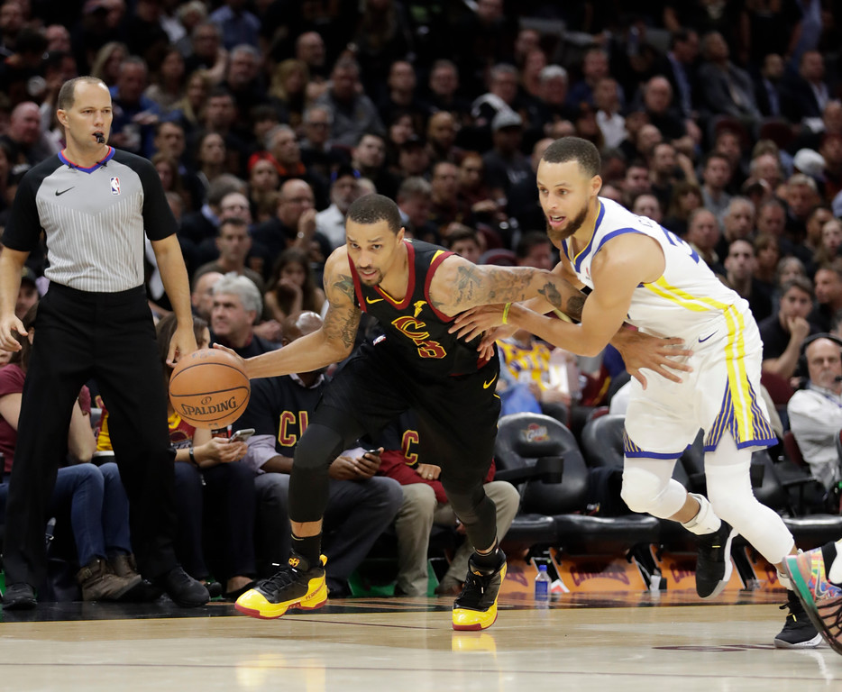 . Golden State Warriors\' David West is defended by Golden State Warriors\' Stephen Curry in the second half of Game 3 of basketball\'s NBA Finals, Wednesday, June 6, 2018, in Cleveland. (AP Photo/Tony Dejak)
