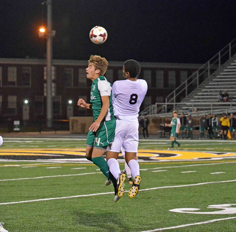 . Paul DiCicco - The News-Herald Lake Catholic\'s Luka Zurak, left, and University\'s George Nageeb vie for a header Oct. 28.