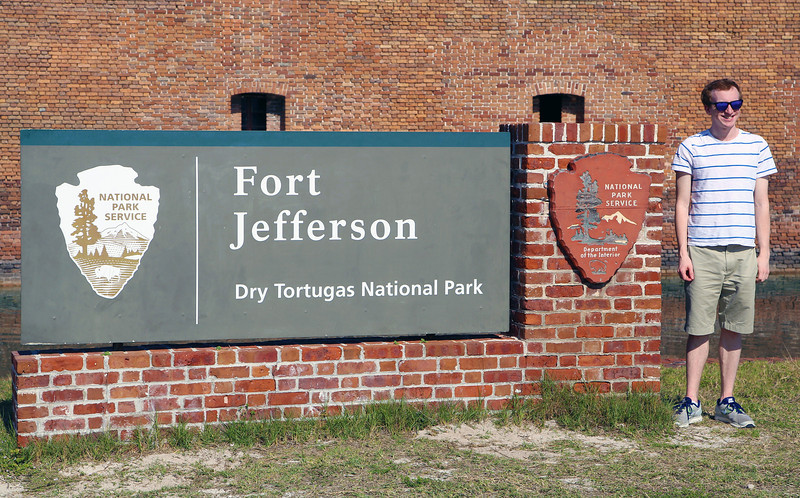 Jasper at the Fort Jefferson sign