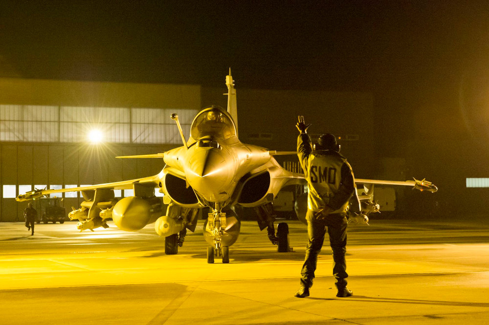Description of . A Rafale fighter prepares for takeoff from the Saint Dizier airbase in central France before being deployed in Mali, in this picture provided by the French Military Communications Audiovisual office (ECPAD) and taken on January 13, 2013. Al Qaeda-linked Islamist rebels in Mali launched a counter-offensive on Monday after three days of strikes by French fighter jets on their strongholds in the desert north, vowing to drag France into a long and brutal ground war. Photo taken January 13, 2013. Mandatory Credit. REUTERS/SGC/Laure-Anne Maucorps/ECPAD/Handout
