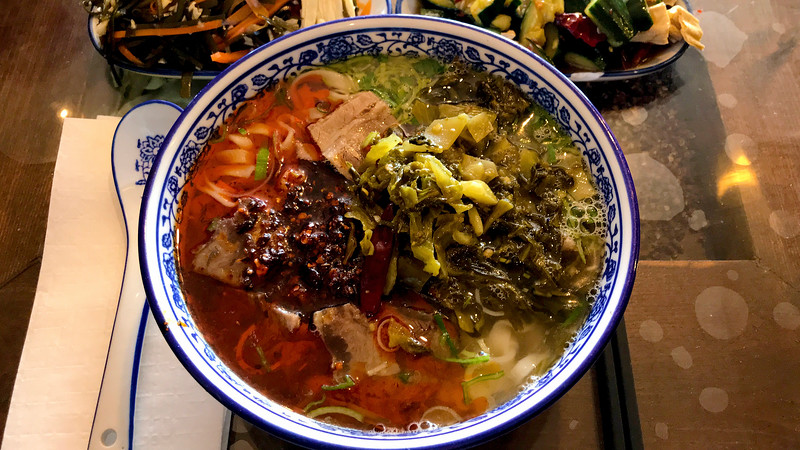 Calanhand-pulled noodles in beef soup with pickled sour mustard.jpg