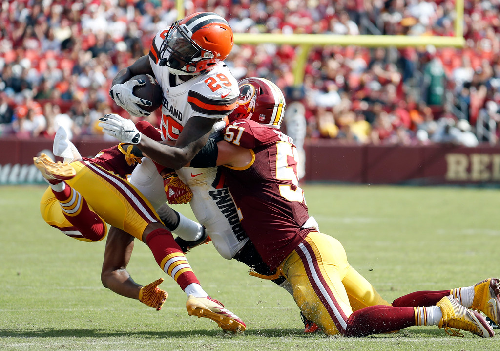 . Cleveland Browns running back Duke Johnson (29) is hit by cornerback Josh Norman, left, and Washington Redskins inside linebacker Will Compton (51) during the second half of an NFL football game, Sunday, Oct. 2, 2016, in Landover, Md. (AP Photo/Carolyn Kaster)