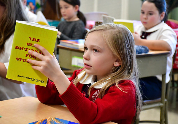 12/11/2018 Mike Orazzi | Staff Eliana Bouchard flips through a dictionary provided by the Rotary Club of New Britain-Berlin for 3 grade students in Mr. Gary Kus' class at the Holy Cross School in New Britain Tuesday morning. Each year the rotary provides all city 3 grade students with dictionaries.