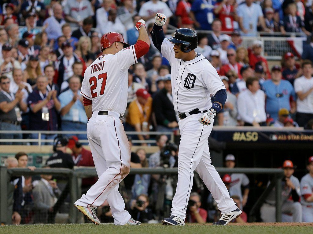 . Miguel Cabrera, of the Detroit Tigers, celebrates with Mike Trout, of the Los Angeles Angels, after hitting a home run during the first inning of the MLB All-Star baseball game, Tuesday, July 15, 2014, in Minneapolis. (AP Photo/Jeff Roberson)