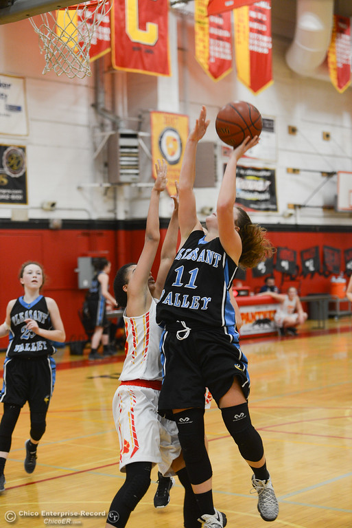 . Pleasant Valley\'s Olivia Layne (11) goes up for a shot against Chico high\'s Adrianie Servin-Smith (23), Thursday, February 8, 2018, in Chico, California. (Carin Dorghalli -- Enterprise-Record)