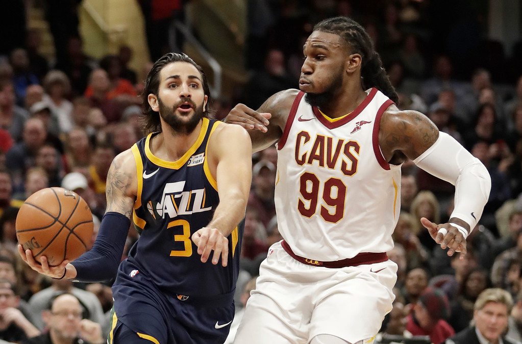 . Utah Jazz\'s Ricky Rubio (3), from Spain, drives against Cleveland Cavaliers\' Jae Crowder (99) in the first half of an NBA basketball game, Saturday, Dec. 16, 2017, in Cleveland. (AP Photo/Tony Dejak)