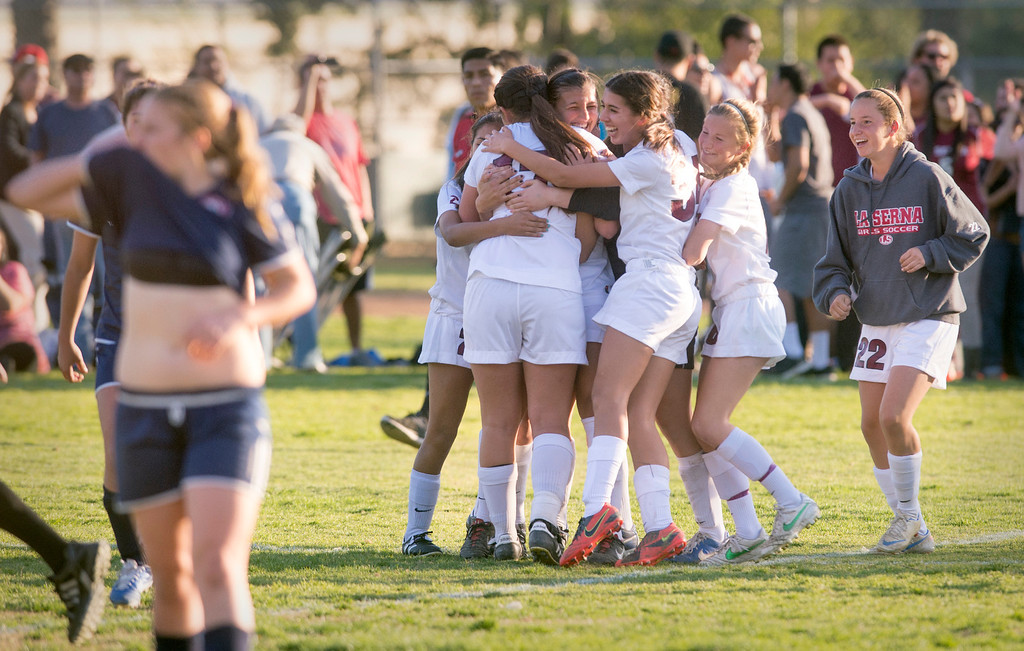 . La Serna High\'s girls\' soccer jubilates after beating La Quinta 3-2 during their Division 5 semifinal matchup Feb. 26, 2013.  (SGVN/Staff photo by Leo Jarzomb)