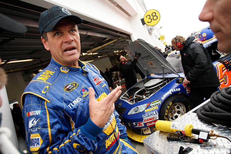 . NASCAR driver Michael Waltrip talks to supporters before practice at Daytona International Speedway in Daytona Beach, Fla., Saturday, Feb. 13, 2010 for Sunday\'s NASCAR Daytona 500 auto race. (AP Photo/J Pat Carter)