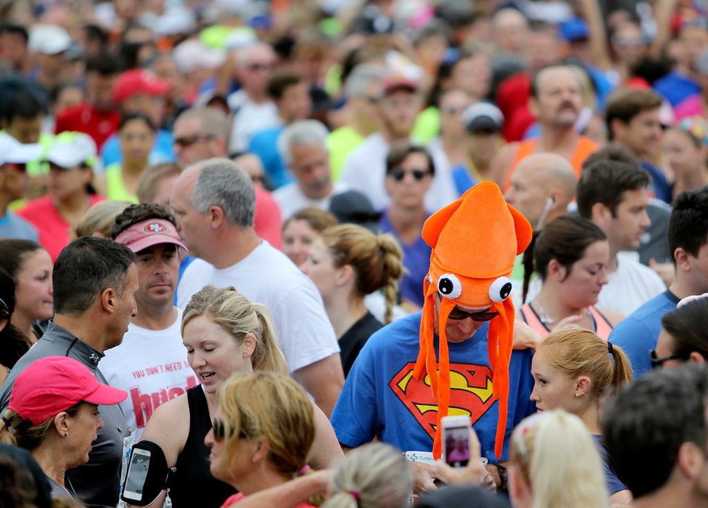 . A bright-orange squid hat stands out in a sea of runners on Beach Street in Santa Cruz on Sunday morning before the start of the 42nd annual Wharf to Wharf race. (Kevin Johnson -- Santa Cruz Sentinel)