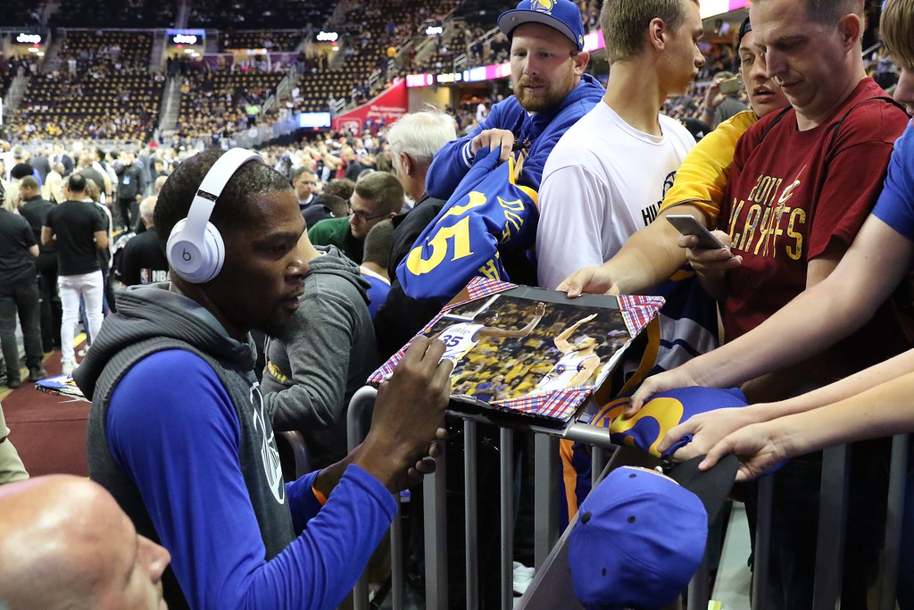 . Tim Phillis - The News-Herald Kevin Durant signs autographs before Game 3 of the NBA Finals between the Cavaliers and Warriors on June 7 in Cleveland.