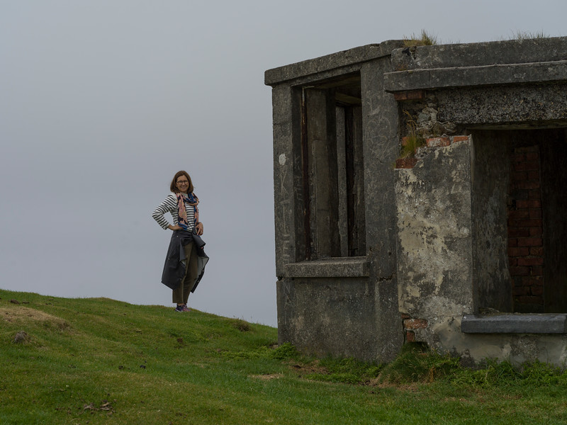 Woman standing near building ruins, Achill Island, County Mayo, Ireland
