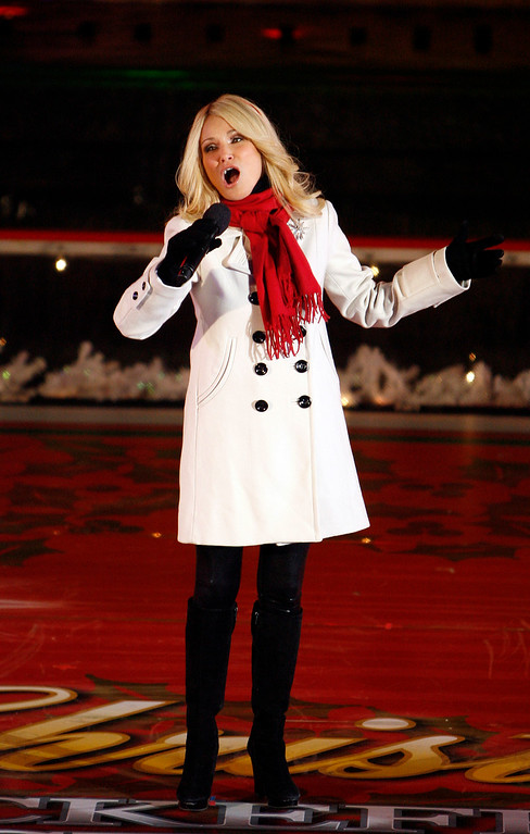 . Actress Kristin Chenoweth performs during the 76th annual Rockefeller Center Christmas tree lighting ceremony Wednesday, Dec. 3, 2008, in New York.  (AP Photo/Jason DeCrow)