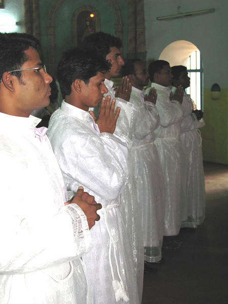 The deacon candidates, (from left) Jijo, Sunil, Michael, Aji, Jose, Sanil, takes their places at the front of the church.