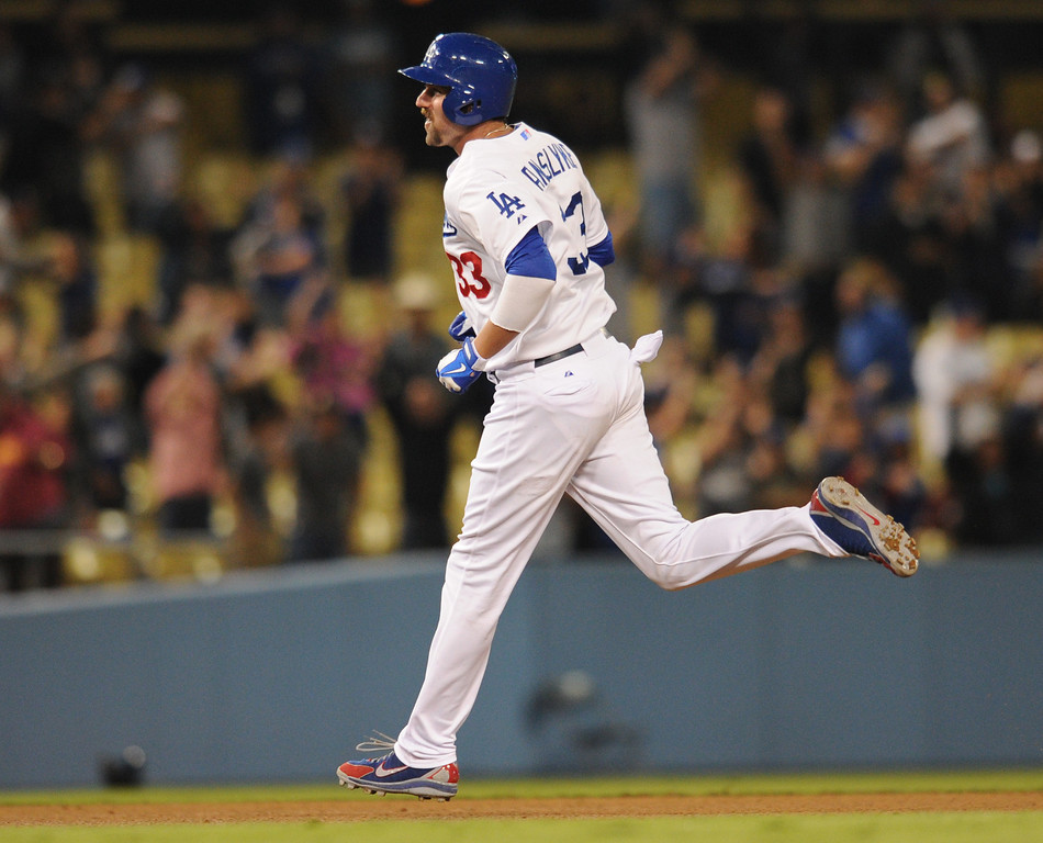 . Scott Van Slyke rounds the bases after his game winning homer. The Dodgers defeated the Arizona Diamondbacks 5-3 after Van Slyke hit a 2 run walk off homer in the 11 inning at Dodger Stadium in Los Angeles, CA. 9/10/2013. photo by (John McCoy/Los Angeles Daily News)