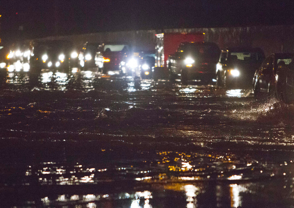 . Westbound traffic on I-44 at Linclon Blvd. drives through flood water on I-44 after a thunderstorm goes through Oklahoma City on Friday, May 31, 2013. (AP Photo/Alonzo Adams)