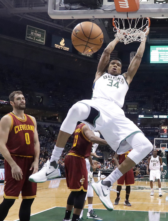 . Milwaukee Bucks\' Giannis Antetokounmpo dunks during the second half of an NBA basketball game against the Cleveland Cavaliers Tuesday, Nov. 29, 2016, in Milwaukee. (AP Photo/Morry Gash)