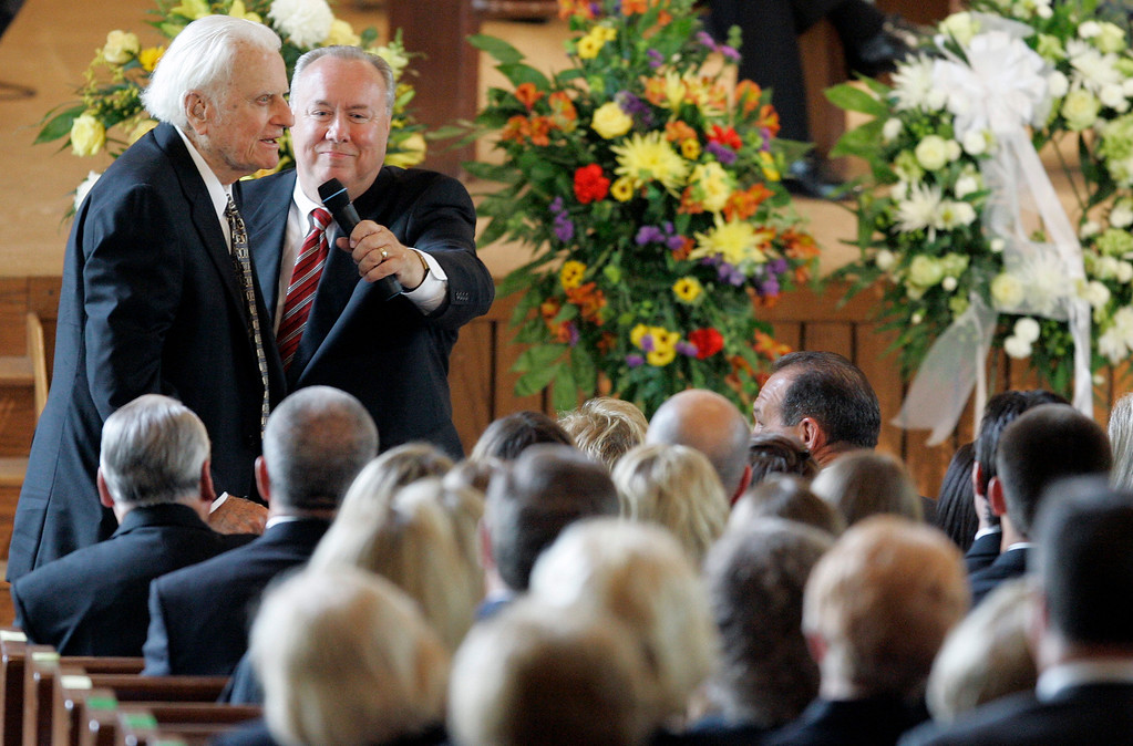 . Billy Graham, left, speaks during a memorial service for his wife, Ruth Graham, in Montreat, N.C., Saturday, June 16, 2007.  (AP Photo/Chuck Burton)