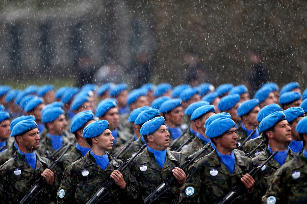 . Members of the Serbian army march under heavy rain during a military parade in Belgrade, Serbia, Thursday, Oct. 16, 2014. (AP Photo/Marko Drobnjakovic)