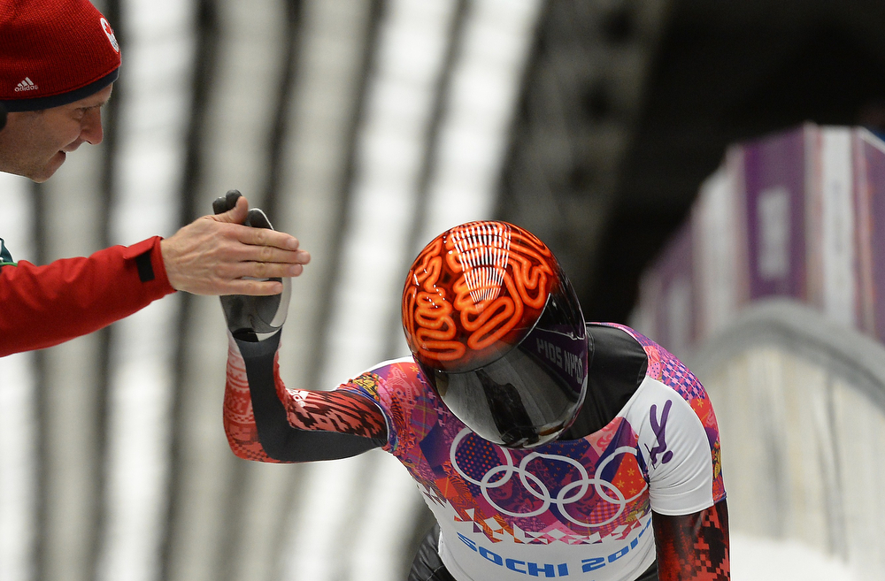 . Canada\'s John Fairbairn reacts after finishing the Men\'s Skeleton Heat 4 and final run at the Sanki Sliding Center in Rosa Khutor during the Sochi Winter Olympics on February 15, 2014. (LIONEL BONAVENTURE/AFP/Getty Images)