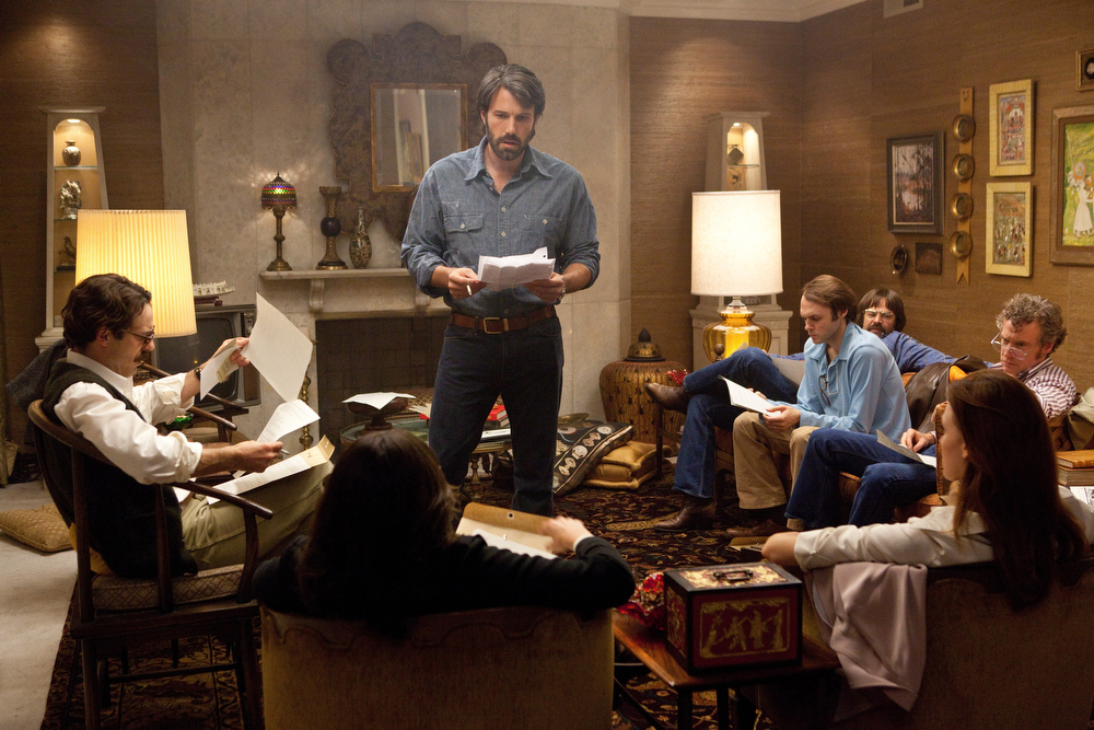 ". This film image released by Warner Bros. Pictures shows Ben Affleck as Tony Mendez, center, in ""Argo,\""  a rescue thriller about the 1979 Iranian hostage crisis. On Thursday, Dec. 13, 2013, Affleck was nominated for a Golden Globe for best director and \""Argo\"" received a nomination for best film.  The 70th annual Golden Globe Awards will be held on Jan. 13.  (AP Photo/Warner Bros., Claire Folger)"
