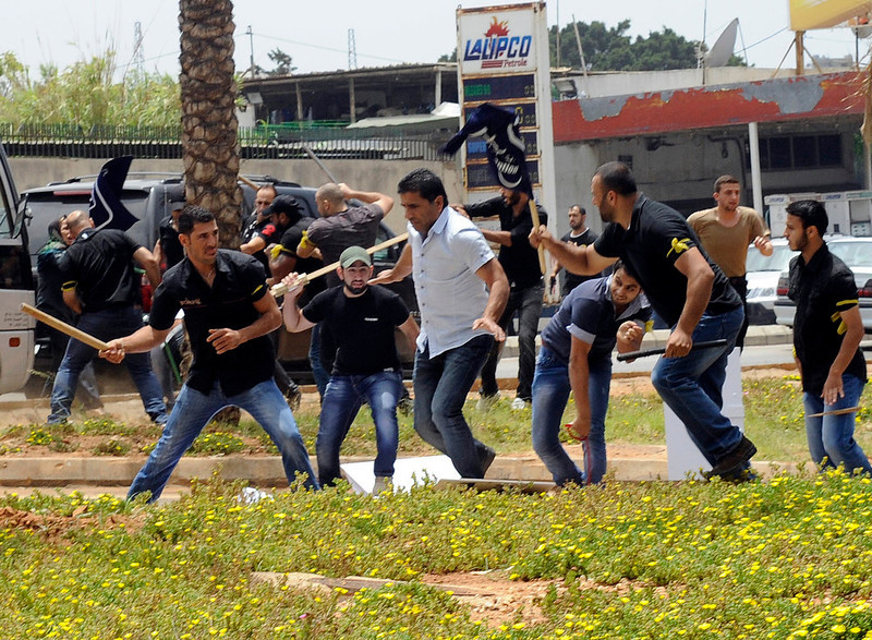 . Hezbollah supporters clash with supporters of the Lebanese Option Party during a protest in front of the Iranian Embassy in Beirut, Lebanon, Sunday, June 9, 2013. A senior Lebanese military official says clashes have erupted outside the Iranian embassy in the capital between protesters opposing Hezbollah\'s participation in the Syrian war and unidentified Lebanese, killing one demonstrator. (AP Photo)