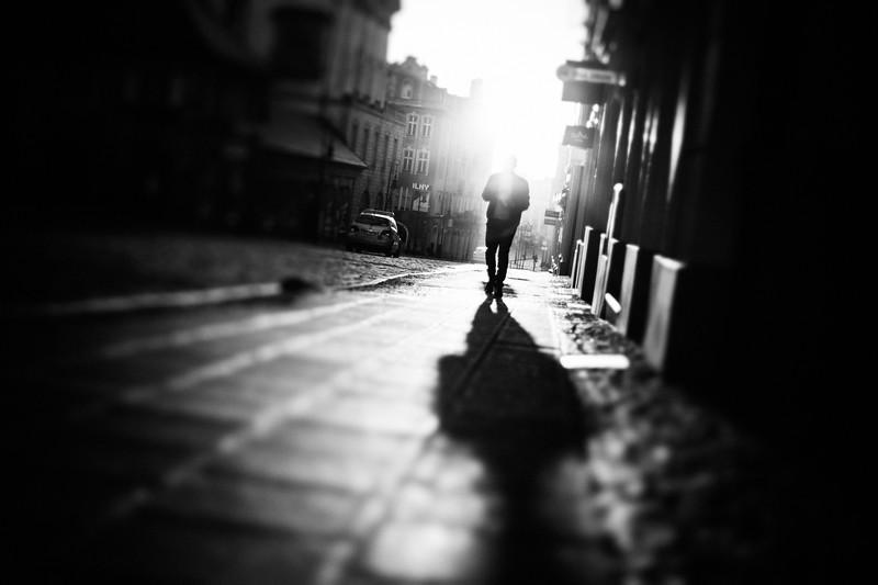 backlit man walking in rynek.jpg