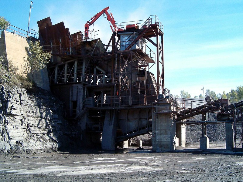 NPK B700 pedestal boom system on platform secondary rock breaking at quarry.jpg